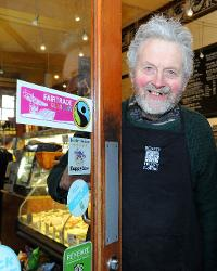 Scott Erwin presents the first Glasgow Fairtrade Logo Sticker to Roots Fruits & Flowers